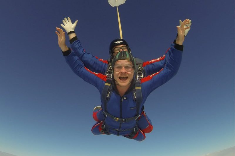 Tandem skydiver Arch and smile